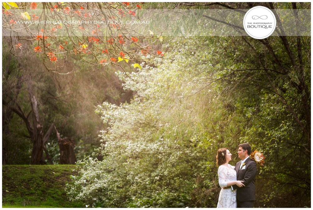 Bride and groom in the landscape at Caves House Yallingup