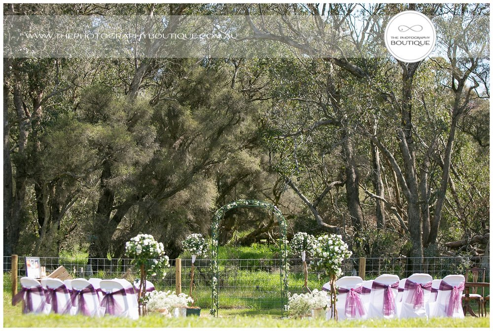 Backyard ceremony garden setup with whites and purples