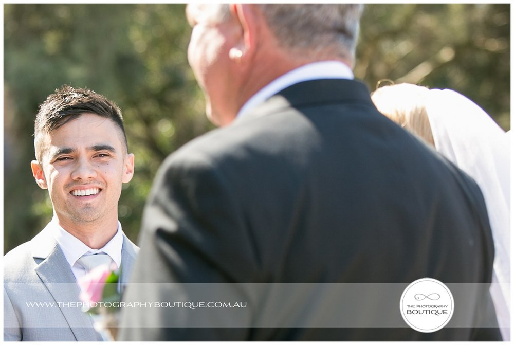 grooms face as bride arrives at roelands backyard wedding
