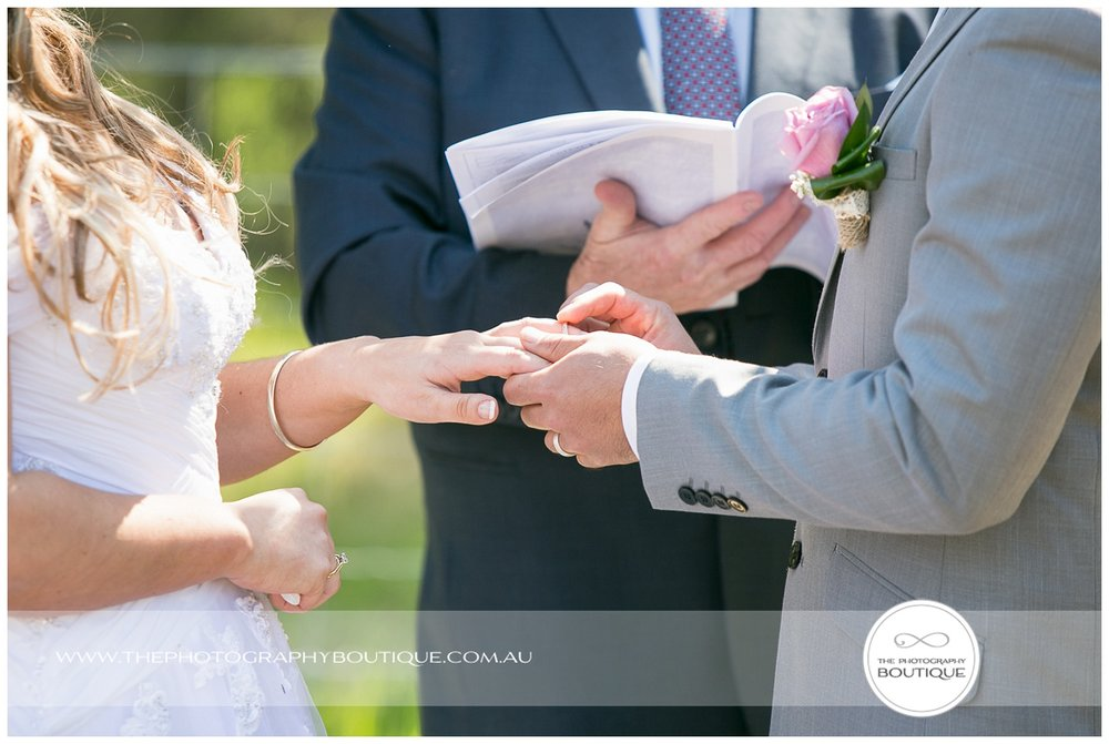 exchanging rings at roelands backyard wedding