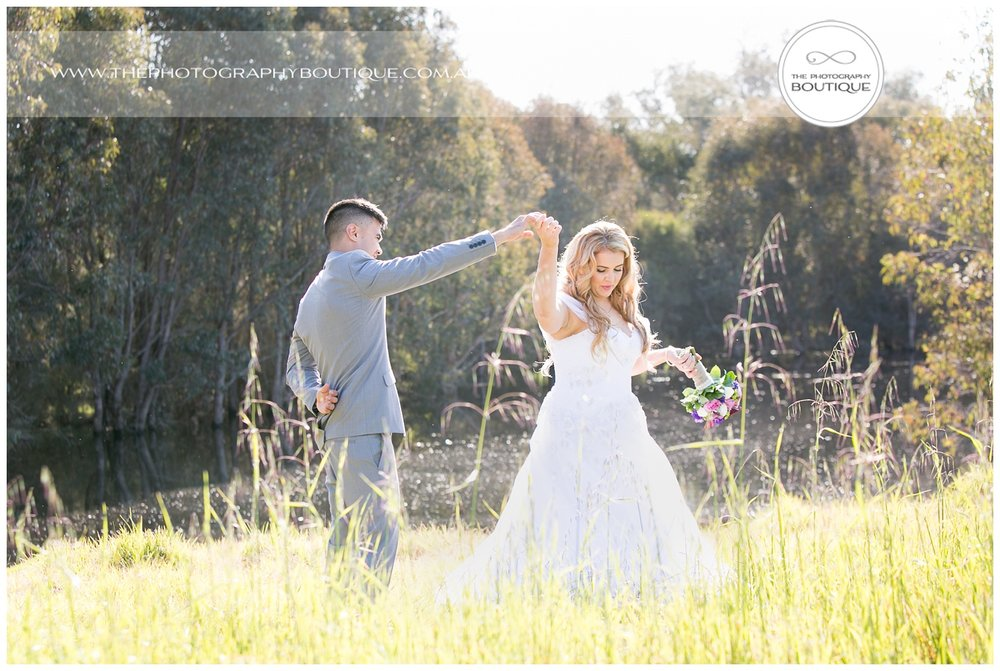 Bride and groom dancing in the park at Roelands Bunbury wedding