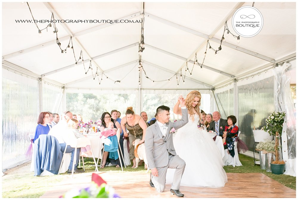 groom on one knee at Roelands Bunbury wedding