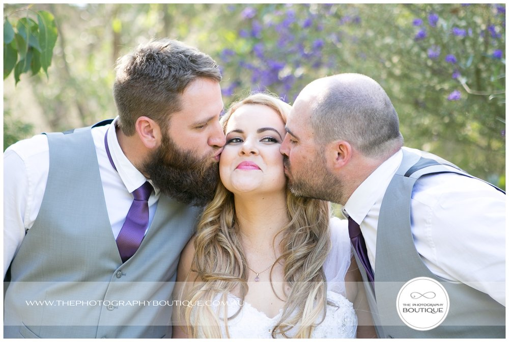Groomsmen kissing the bride at Roelands Bunbury wedding