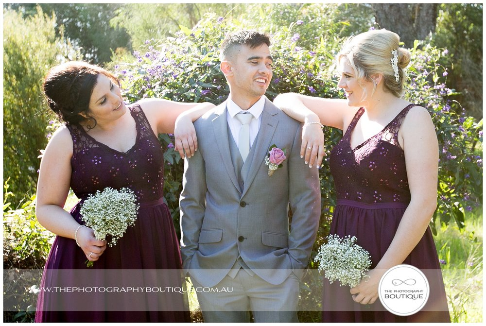 Groom with the bridesmaids at Roelands Bunbury wedding