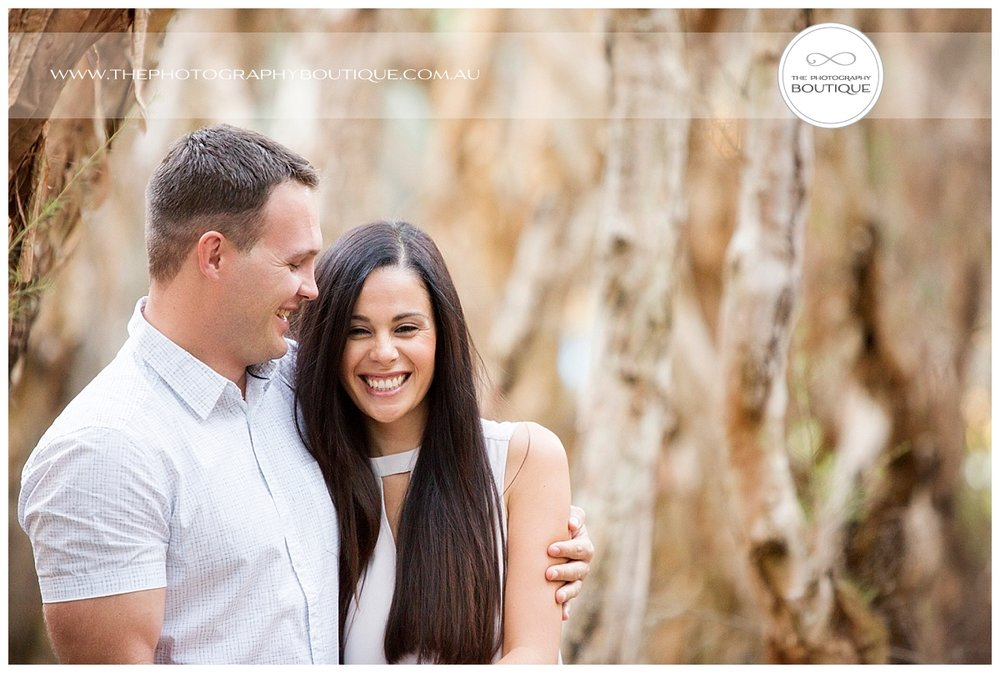 The Photography Boutique Engagement Couple Beach_0110.jpg