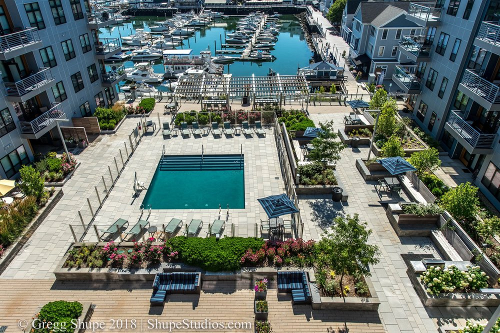 A pool in a courtyard needs to be shot midday so that it is not shadowed by the adjacent apartment/condos that often surround a pool.
