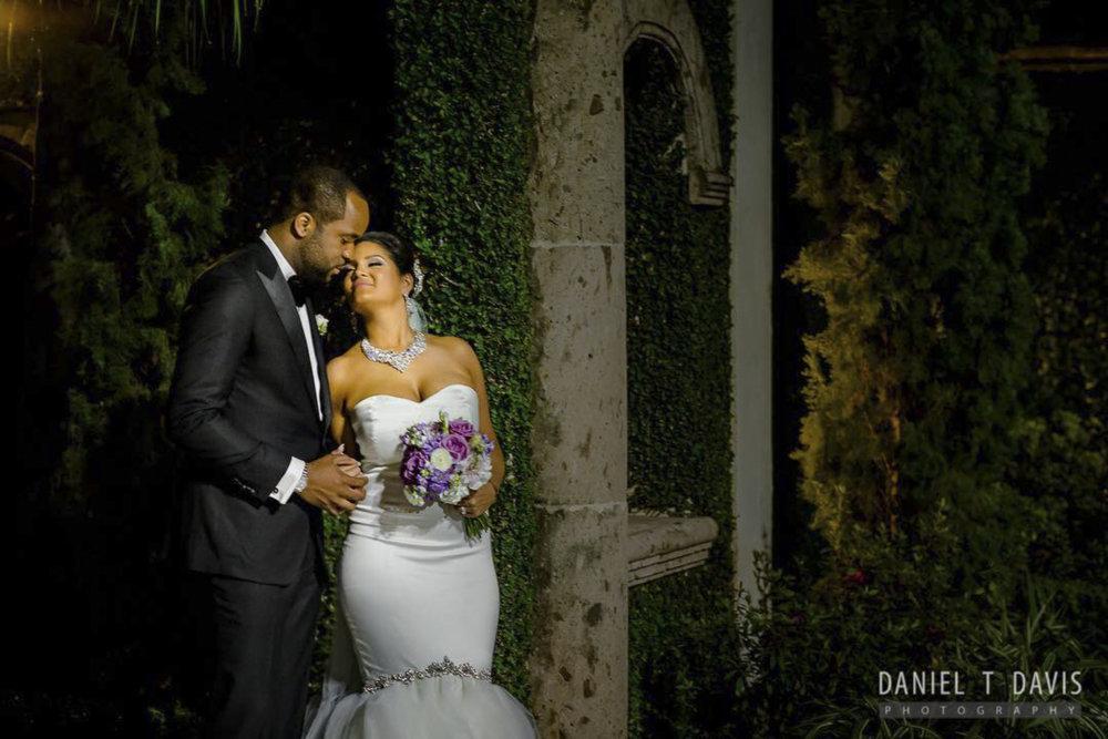 Bride and Groom Kiss outside Chapel Doors.jpg