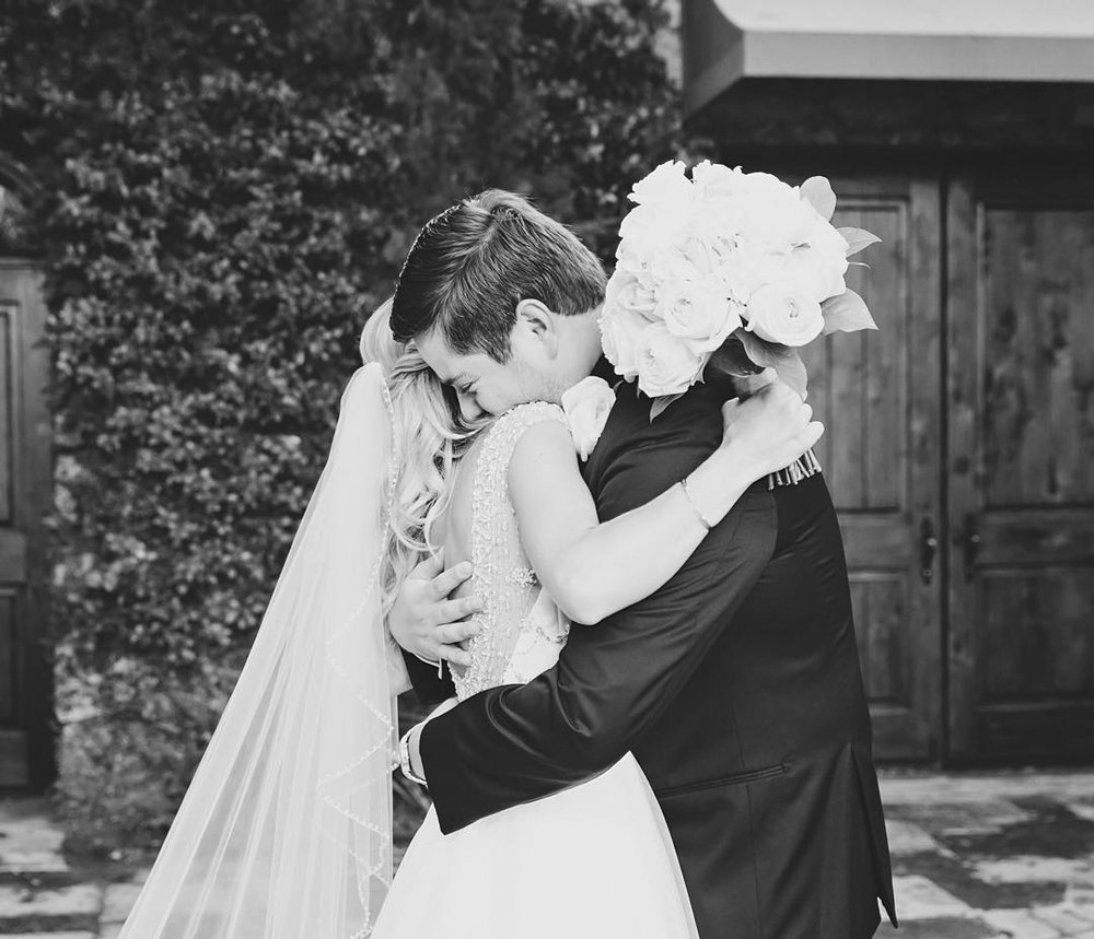 Black and White First Look Embrace in Contessa Courtyard.jpg