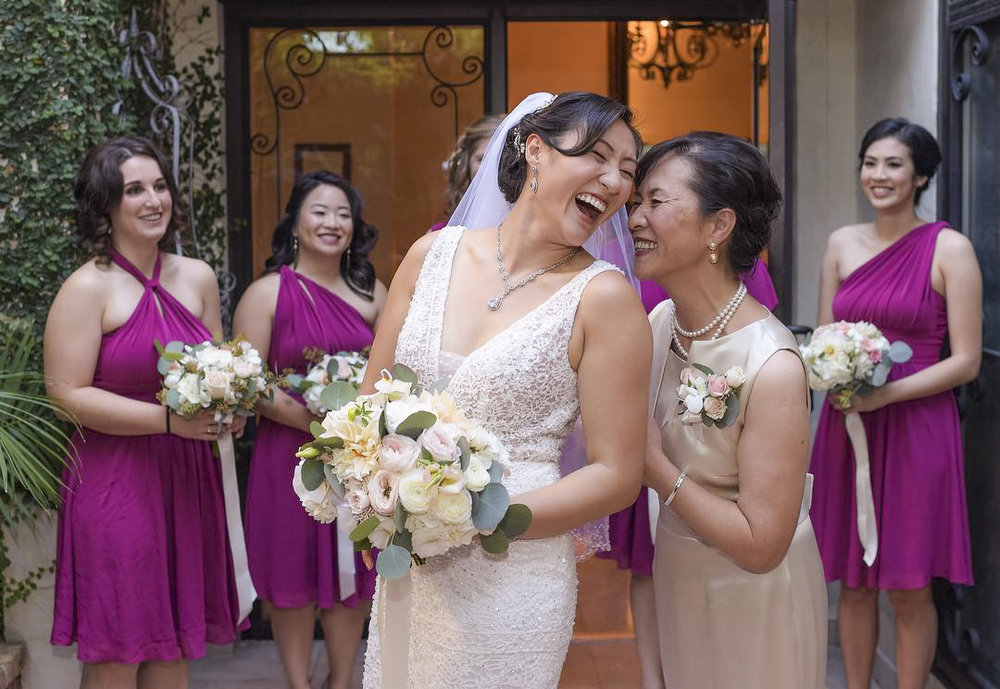 Bridal Party laughing in chapel bridal suite courtyard.jpg