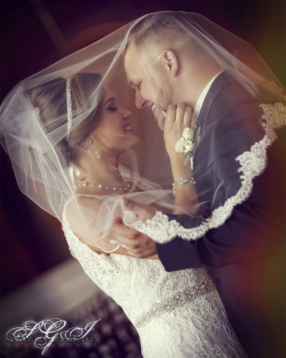 Bride and Groom Embraced under Veil in Candela.jpg