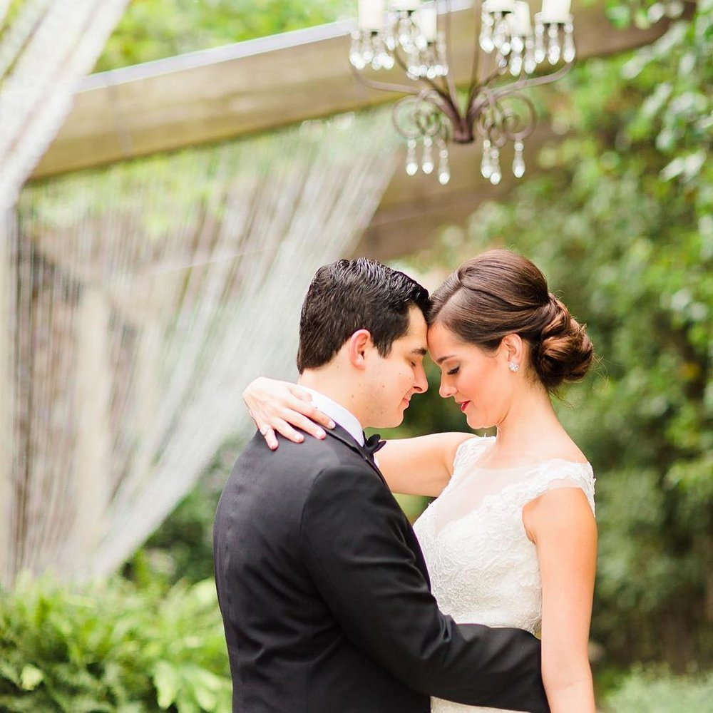 Bride and Groom Embrace in Candela Courtyard.jpg