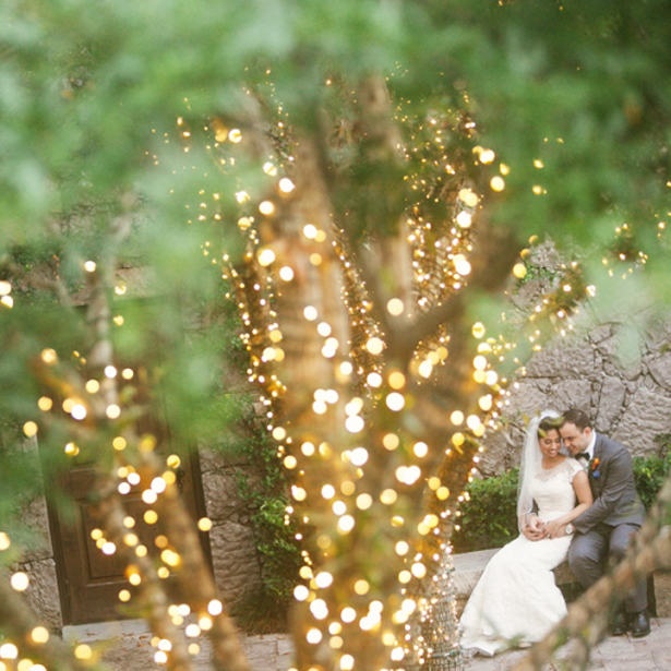 Bride and groom sitting in Contessa Courtyard.jpg