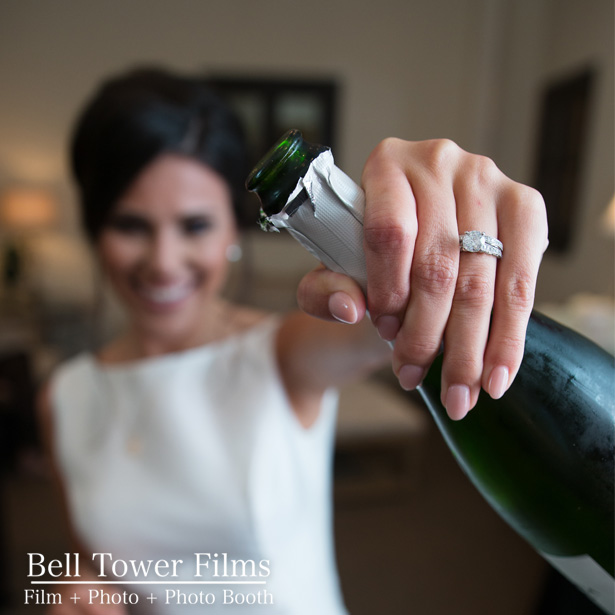 Showing off Ring with Champagne Bottle.jpg