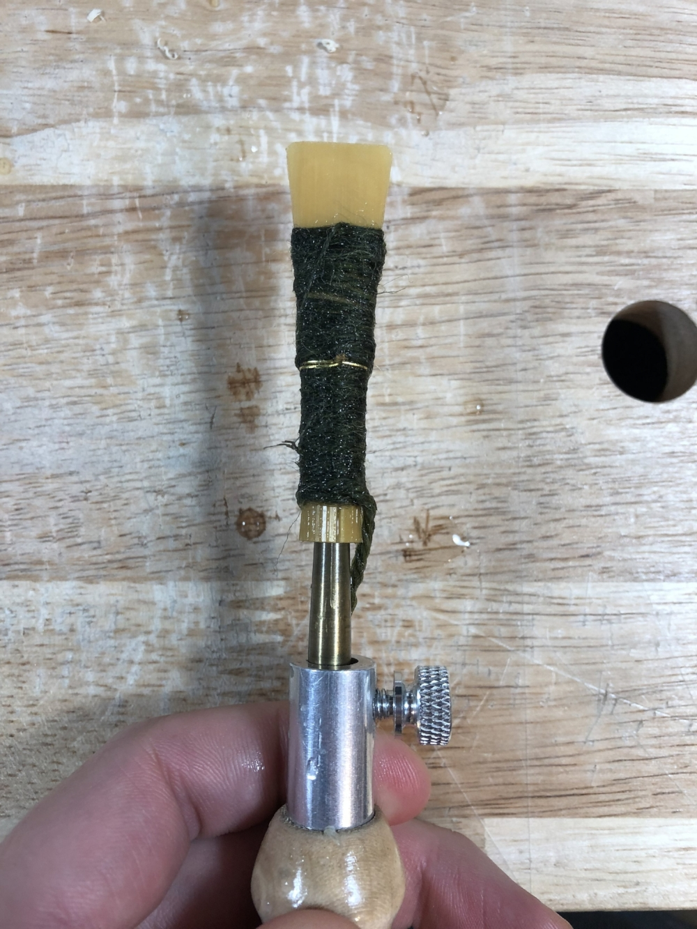 Forming the Reed! - Insert the mandrel in the center of the back end of the reed. Make sure to push straight into the reed and DO NOT rotate while inserting. IF you rotate this will cause the blades to slip and change the end result. Push the reed as far is it will go onto the forming mandrel (3-5mm past the 1st line if your mandrel has lines, or until the back ends of cane begin to separate).