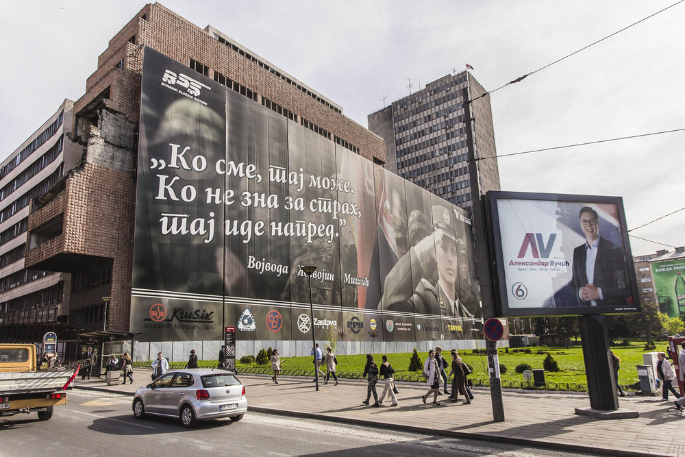A gigantic advertisemnt covers the signs of the Nato bombings over the former Headquarters of the Serbian Army. On a side the omnipresent advertisment of Vucic election campaign.