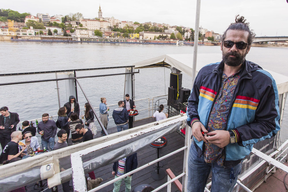 The manager of the famous 20/44 is portraied on the second level of the club during the inauguration of spring summer season site on a reconstructed boat with a raft beside on the river Sava