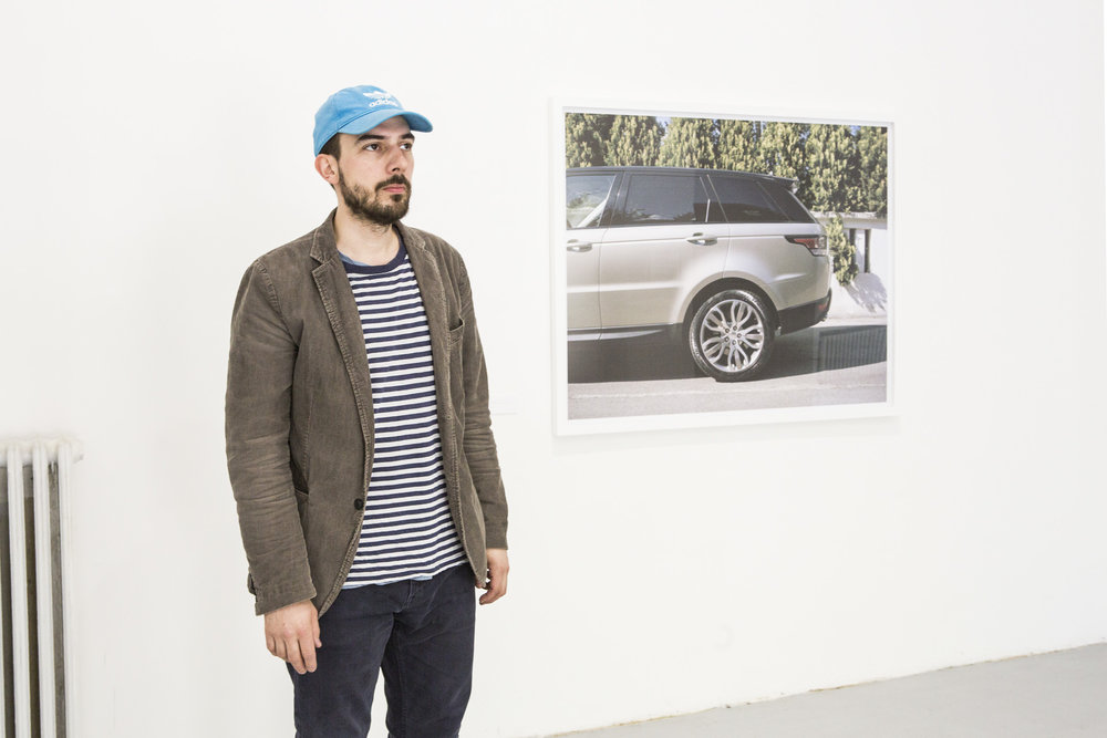 The photographs display attributes of new wealth such as designer houses, yachts, SUV cars, and yet, they also focus in on the signifiers of paranoia arising from a fear of the world outside
