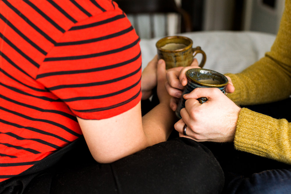 sharing coffee together during an intimate in-home couples session in Kansas City, MO