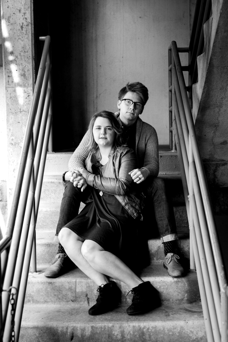 engaged or married couple sitting in a parking garage in Westport Kansas City, MO black and white photography