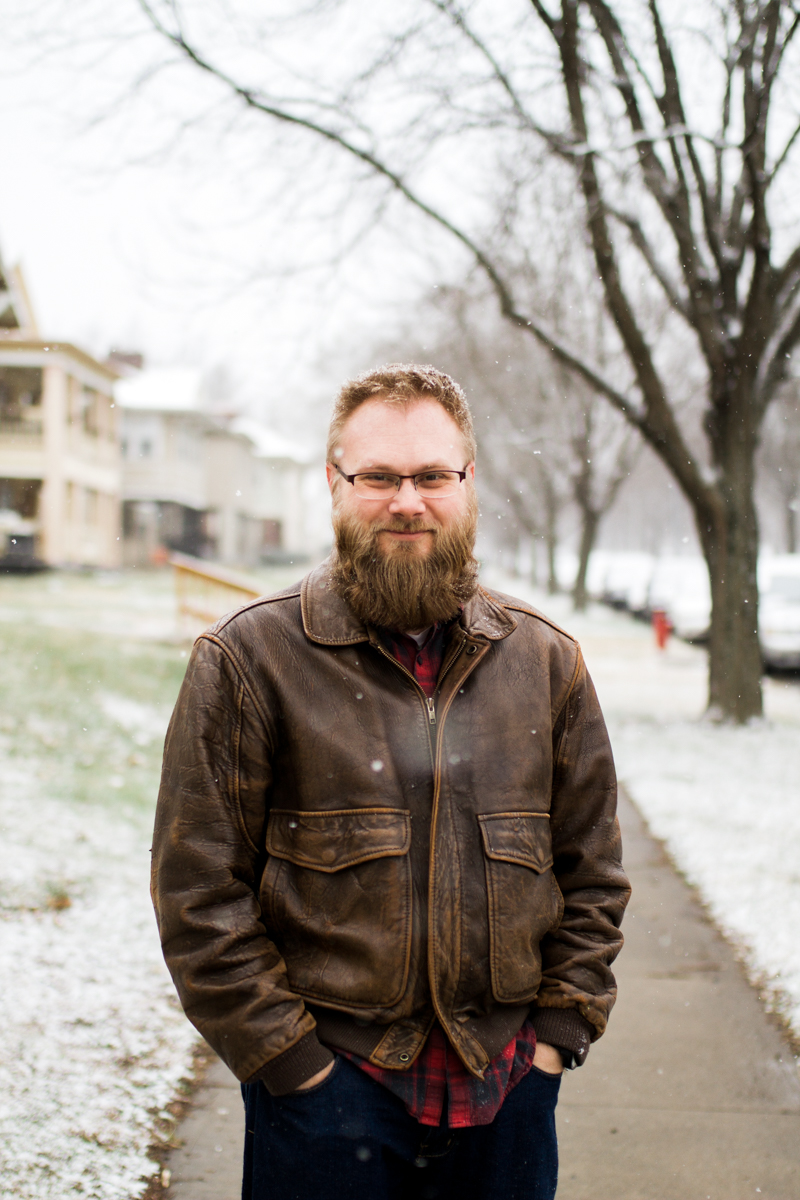 Kansas City, MO lifestyle family photographer bearded man in the snow winter family photography