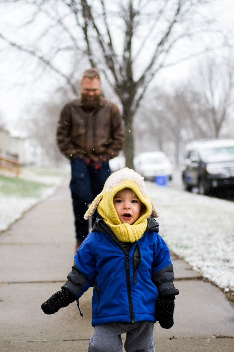 Kansas City, MO lifestyle family photographer father and son in the snow winter family photography