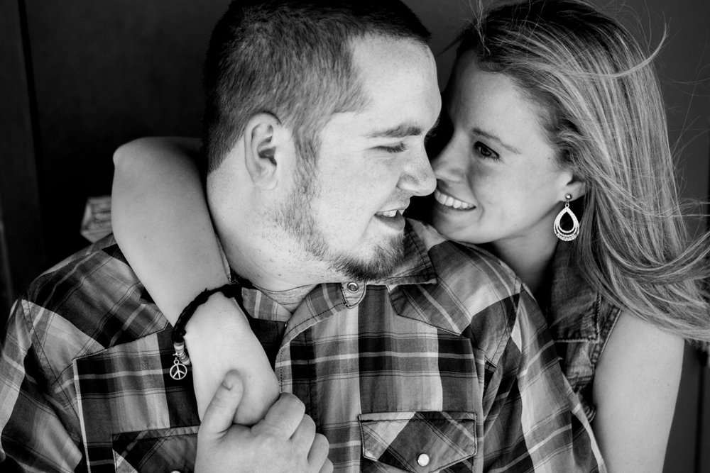 Couples session in Kansas City west bottoms couples photography holding hands black and white photo