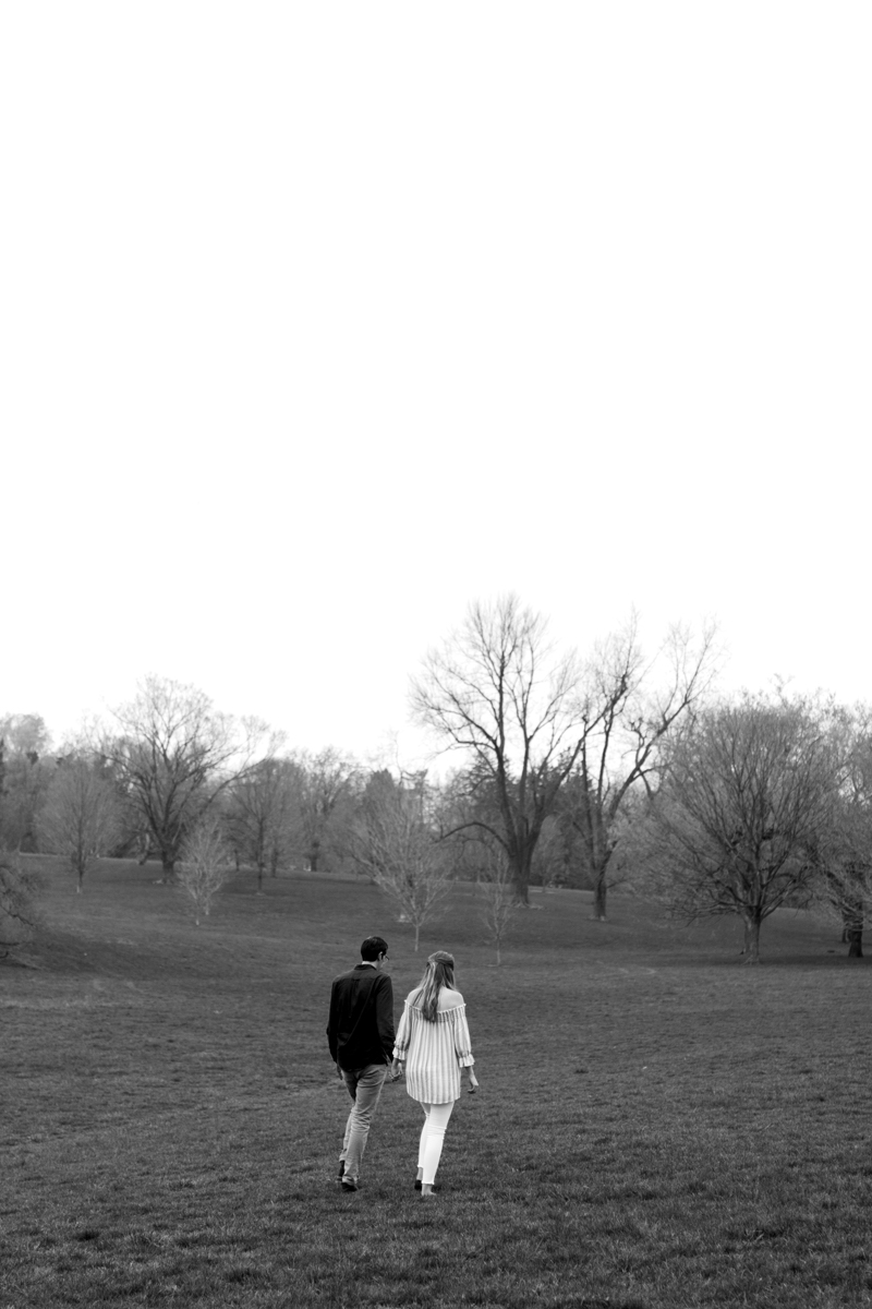 Kansas City Loose Park spring maternity session walking across the hills black and white photo Kansas City Maternity photographer