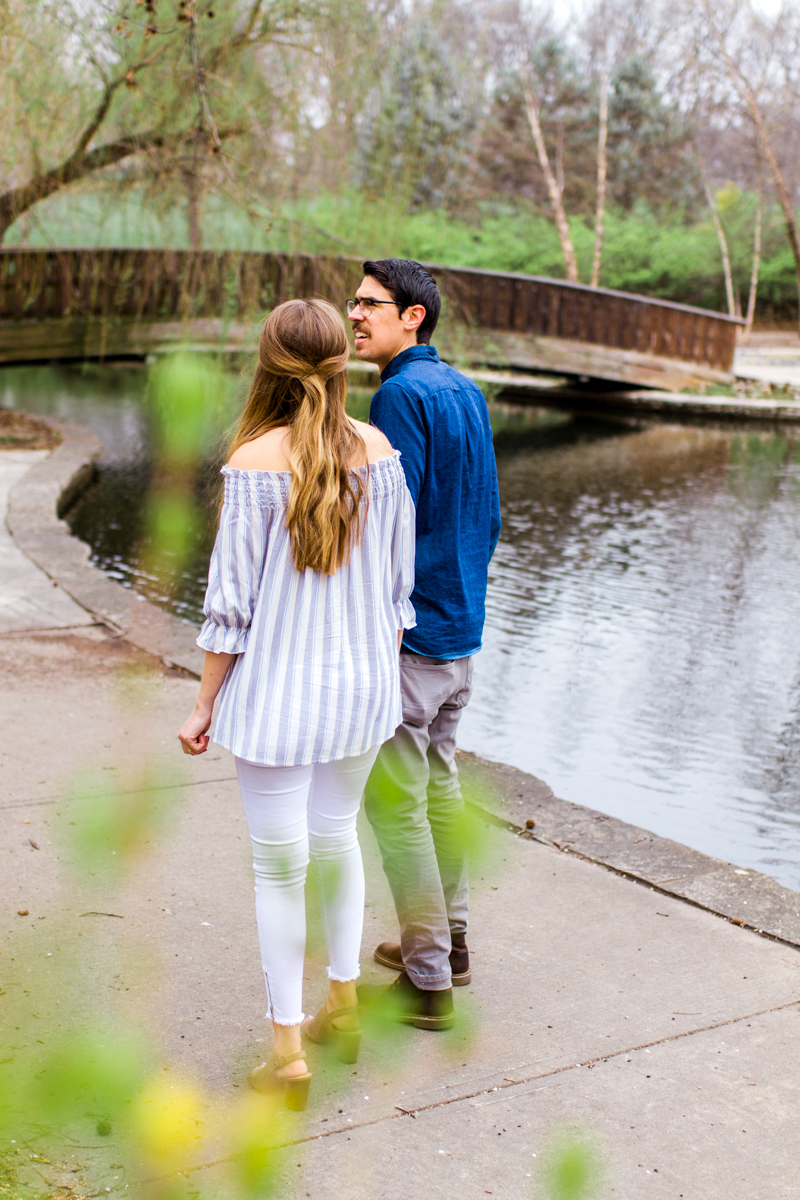 Kansas City Loose Park spring maternity session walking by the pond holding hands Kansas City maternity photographer