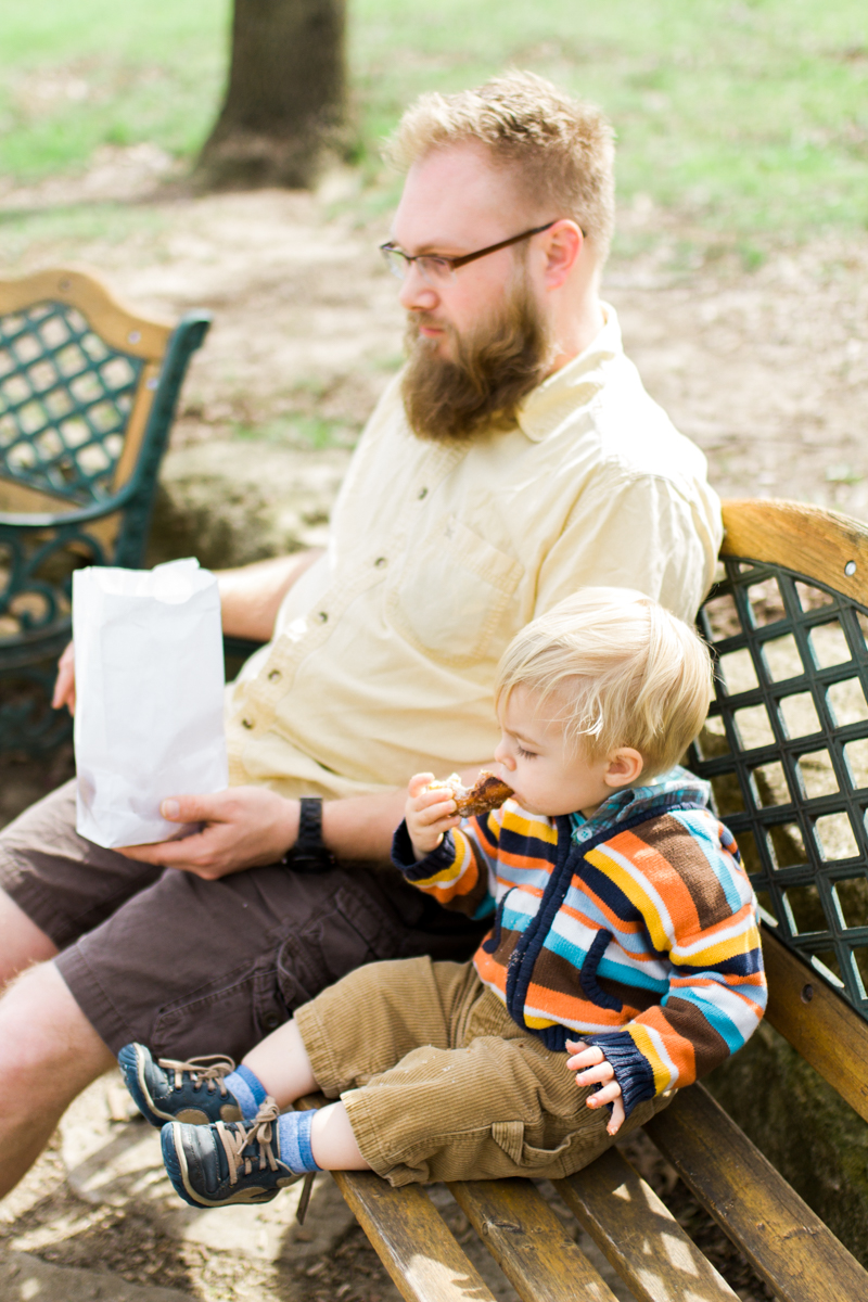 Kansas City family photographer father and son eating a donut Cider Hill Family Orchard