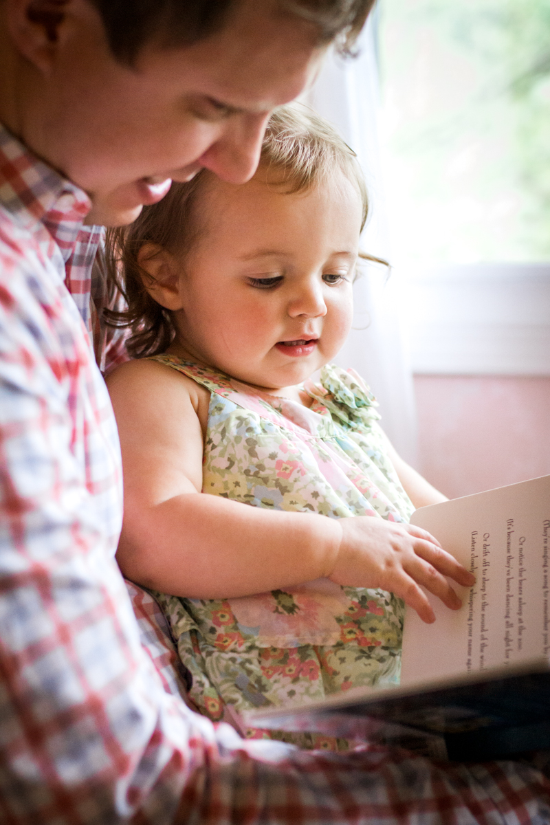 Kansas City Family photographer, in-home lifestyle family photography father and daughter reading together Rebecca Clair Photography