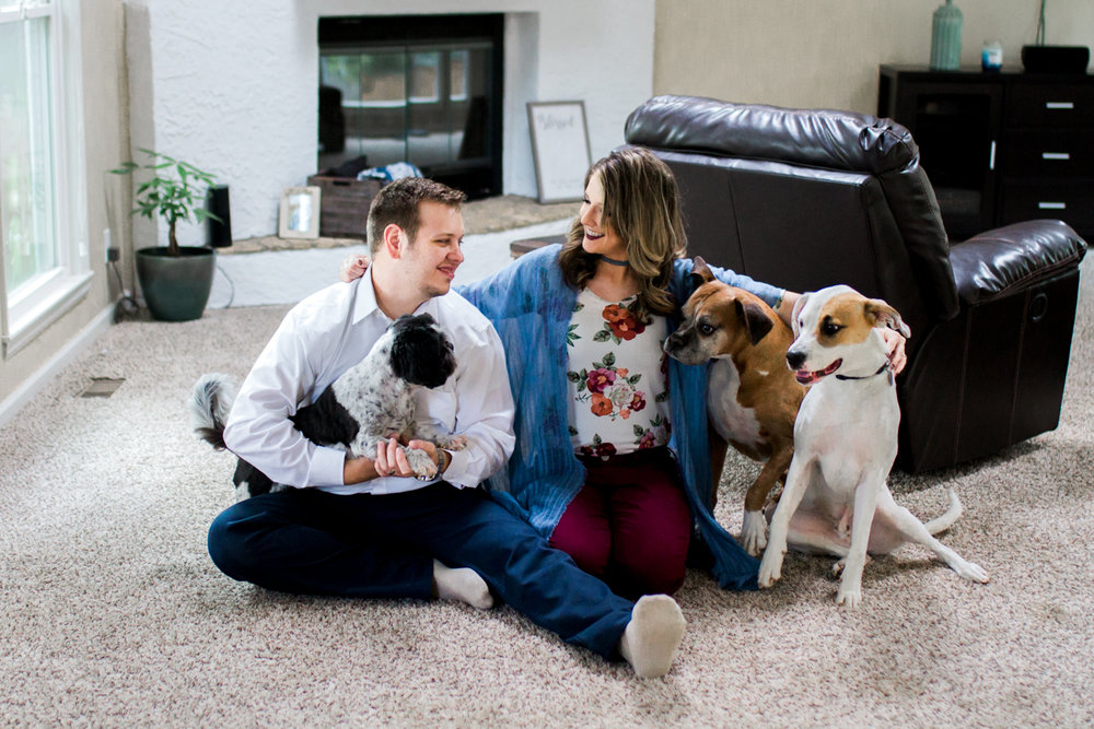 Kansas City lifestyle photographer in home couples session with their dogs engagement photos