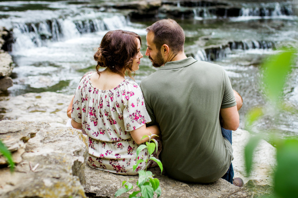 Rebecca Clair Photography Kansas City MO lifestyle family photographer Line Creek Trail Family Session couple about to kiss by waterfall couples photography