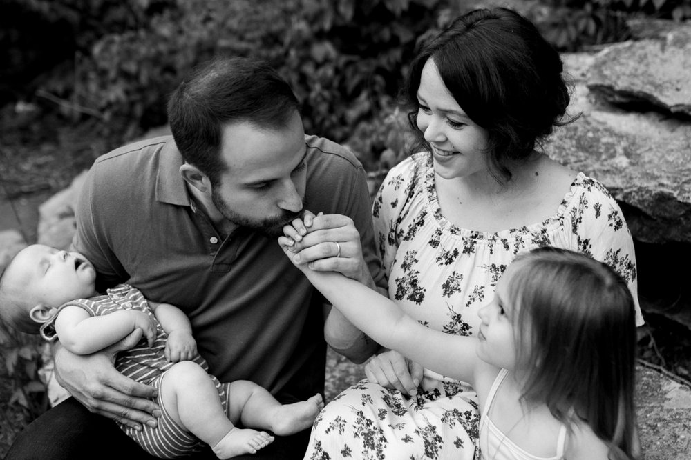 Rebecca Clair Photography Kansas City MO lifestyle family photographer Line Creek Trail Family Session father kissing his daughter's hand black and white photo