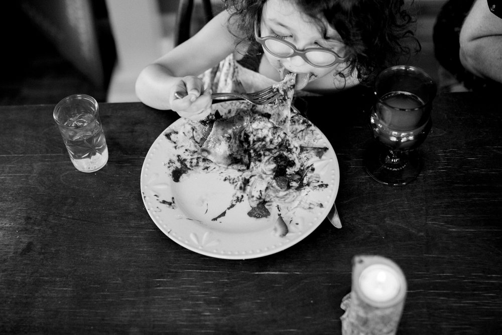 Kansas City small business lifestyle photography seven swans creperie girl eating crepe dinner party