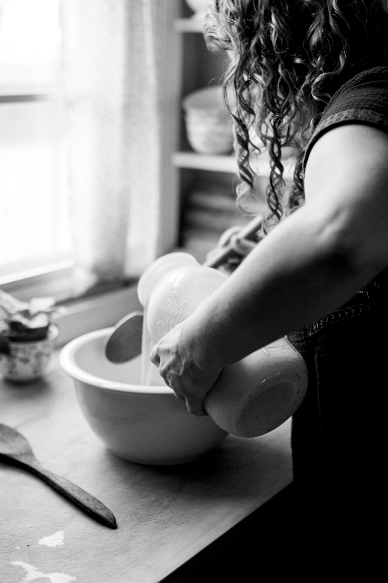 Kansas City small business lifestyle photography seven swans creperie woman making crepes black and white photo