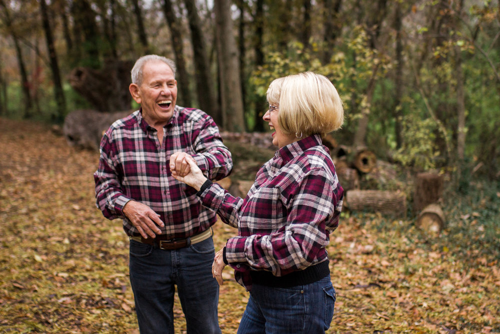 Kansas City lifestyle photographer, Kansas City family photographer, extended family session, fall family photos in the woods, older couple dancing, grandparents portrait