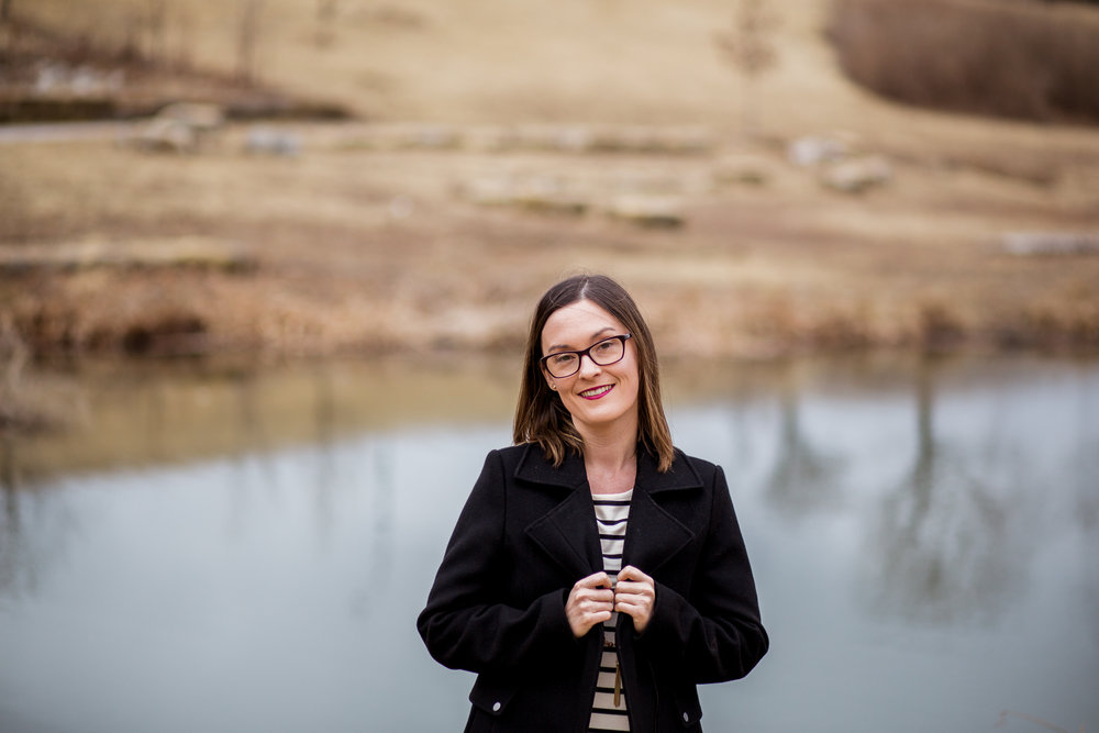 Candid portrait of woman standing by winter pond, Kansas City lifestyle photographer, Kansas City senior photographer, Kansas City small business headshots, Kansas City lifestyle blogger, candid portrait, winter portrait session, Penn Valley Park