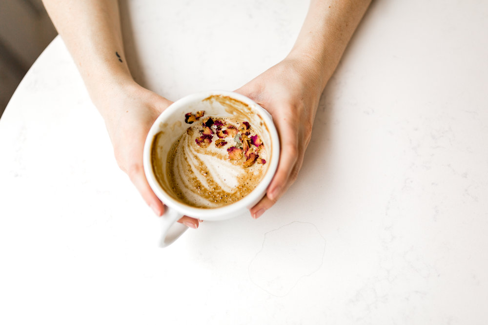 Latte with rose petals in a coffee shop, Kansas City lifestyle photographer, Kansas City senior photographer, Kansas City small business headshots, Kansas City lifestyle blogger, candid portrait, winter portrait session, Monarch Coffee