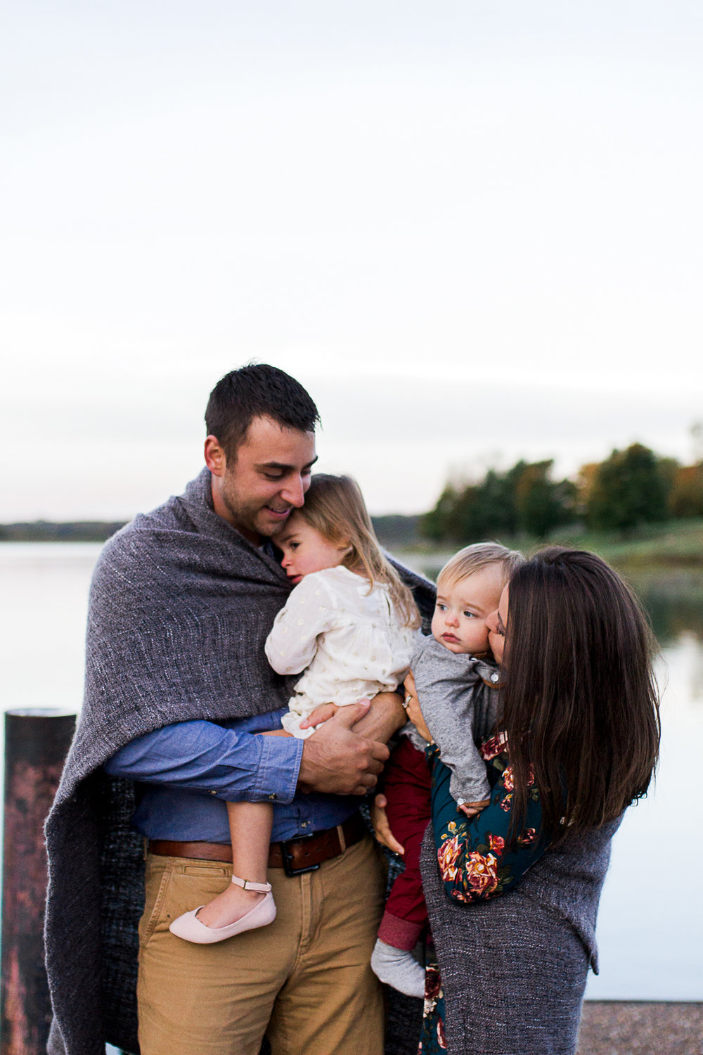 Candid family portrait wrapped in a blanket, sunrise family session at Shawnee Mission Park, Rebecca Clair Photography