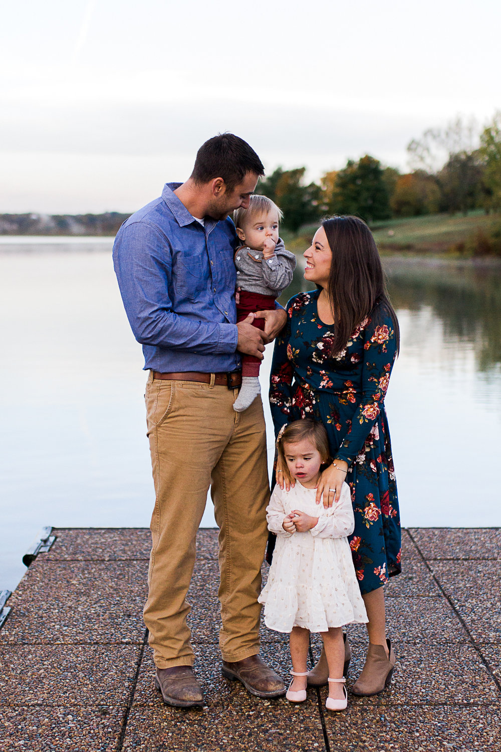 Family photo on the dock, Kansas City lifetyle photographer, sunrise family session at Shawnee Mission Park, Rebecca Clair Photography