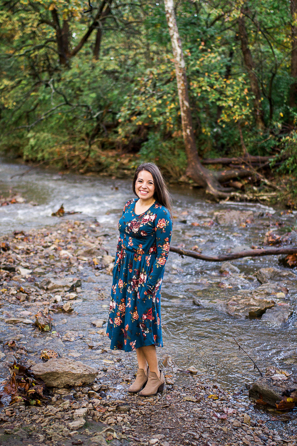 Woman stands at the edge of the stream, fall family photos, Kansas City lifestyle head shots and branding session, Rebecca Clair Photography