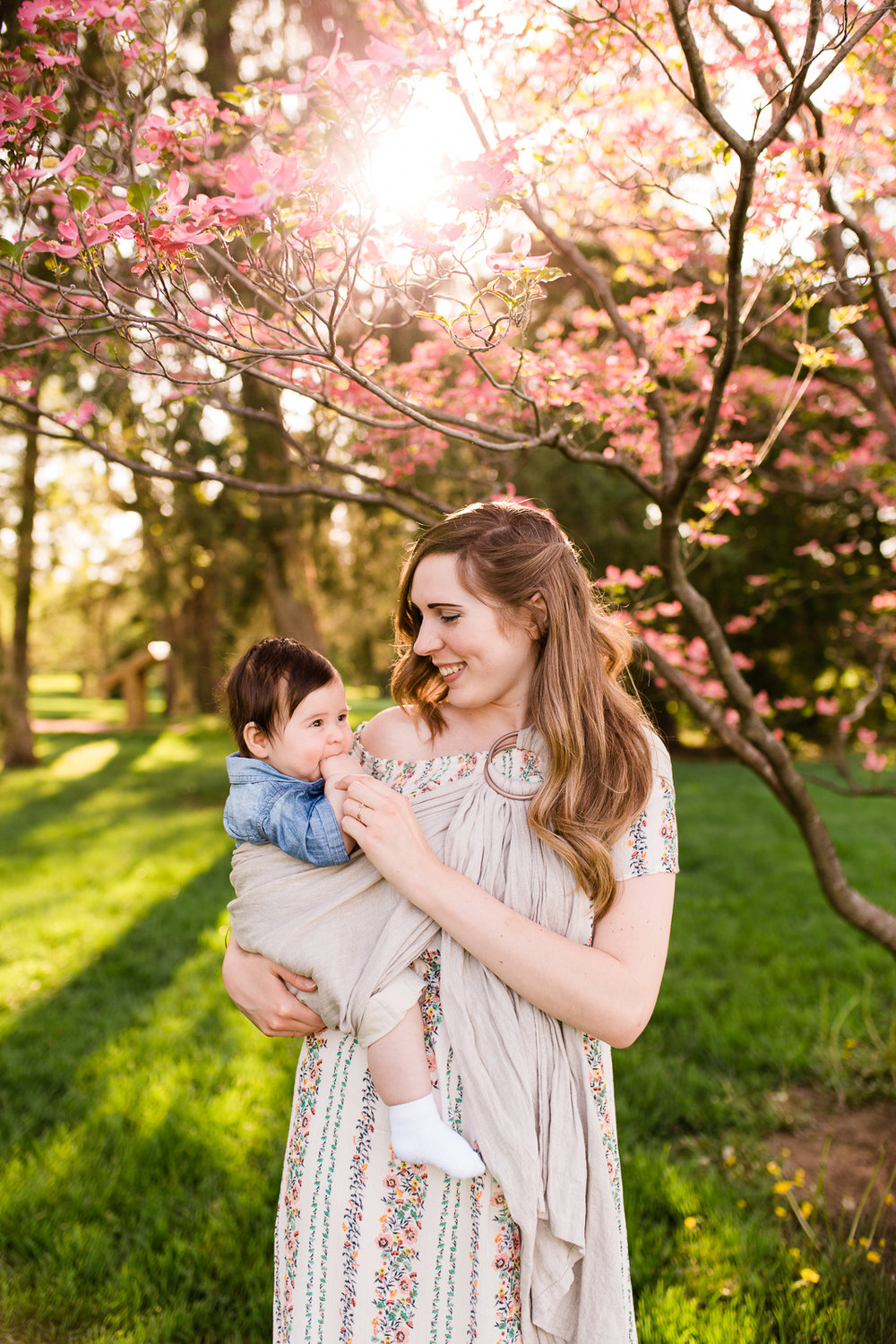 mother holding her baby under a flowering tree, Loose Park mommy and me session, Kansas City family photographer, Rebecca Clair photography