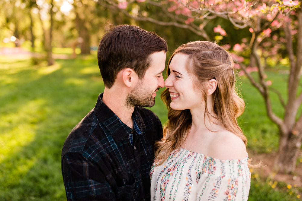 Couple giggling together, spring couples session at Loose Park, Kansas City anniversary session, Rebecca Clair Photography