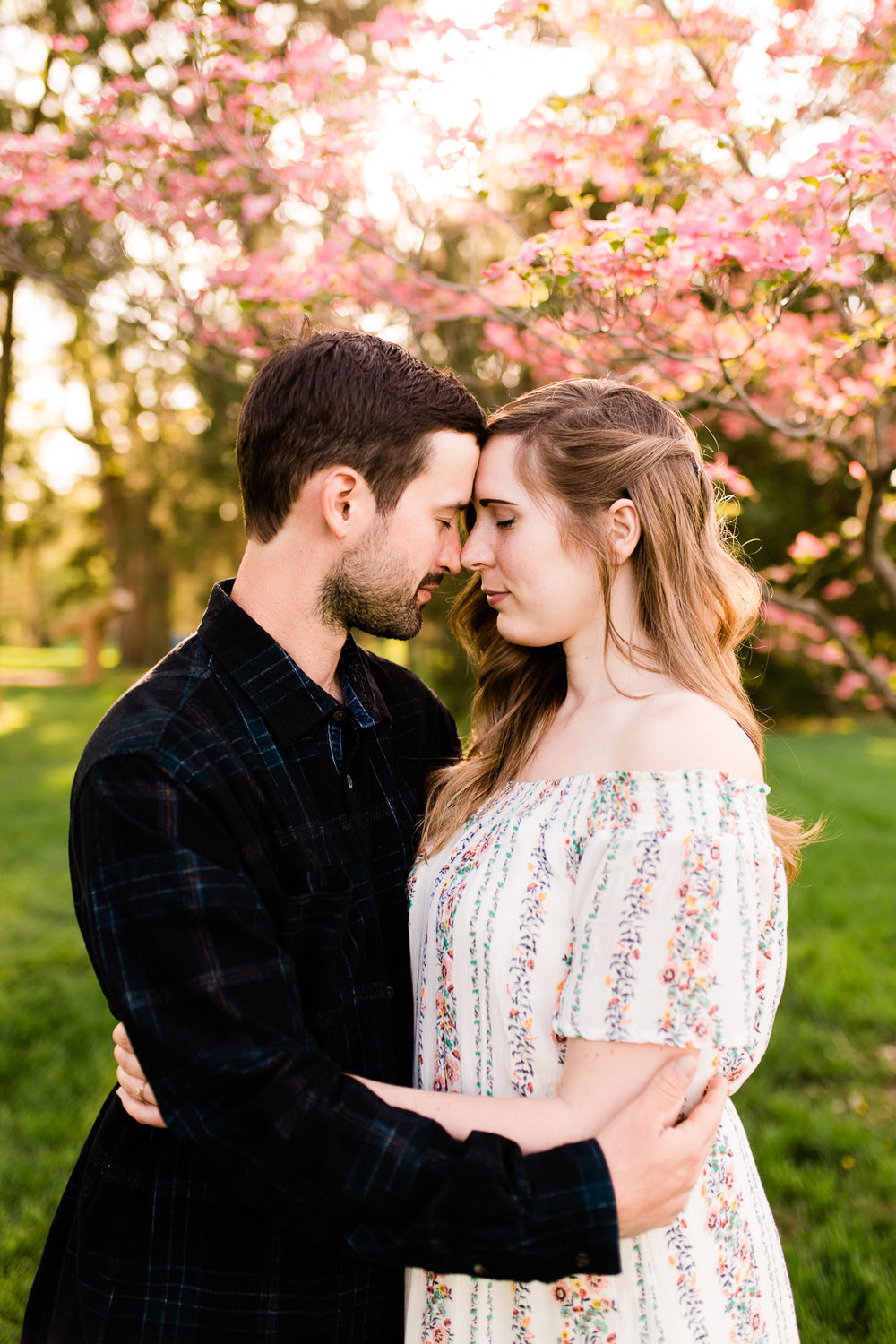 Couple touching foreheads, married couple under flowering trees, Kansas City couples photographer, Rebecca Clair Photography