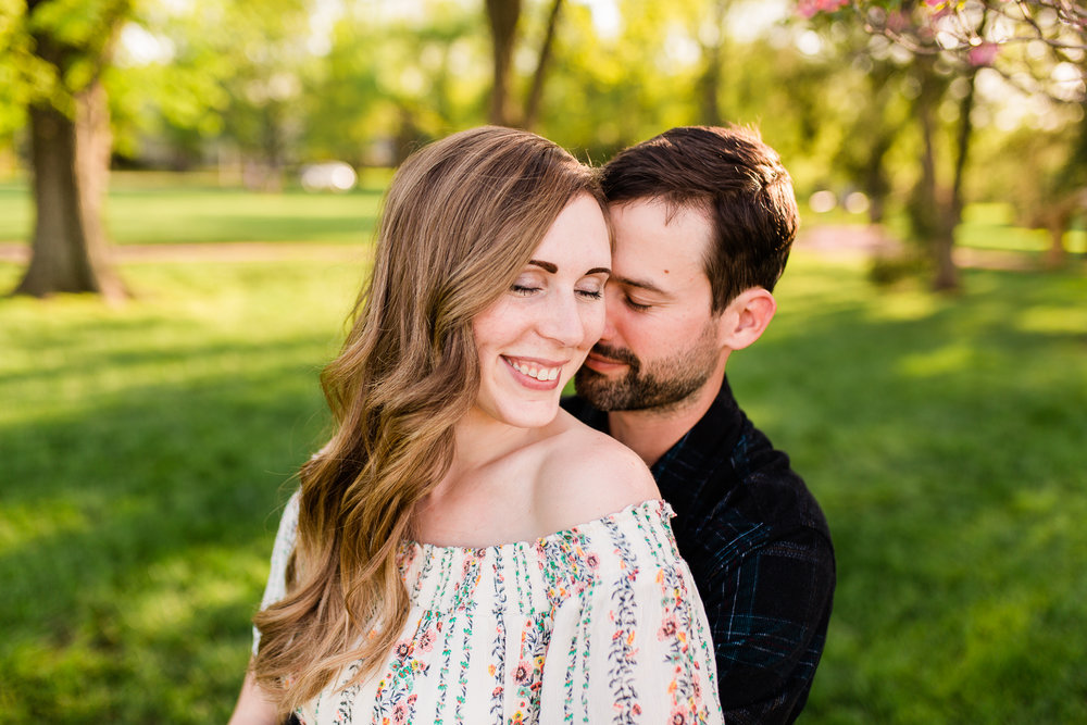 Couple embraces in the golden light, Loose Park spring session, Kansas City couples photographer, Rebecca Clair Photography