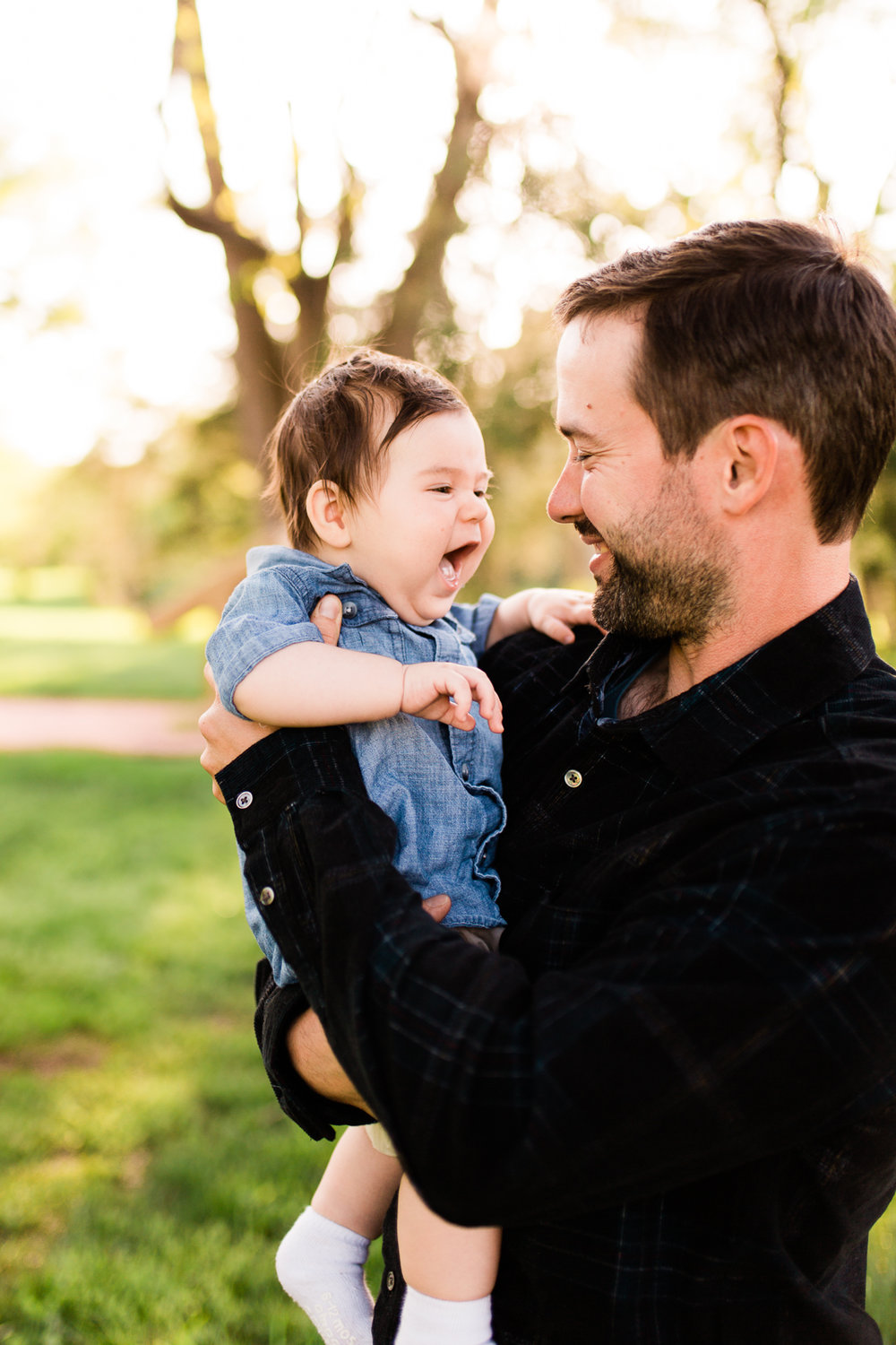Father holding giggling baby, spring family session at Loose Park, Kansas City family photographer, Rebecca Clair Photography
