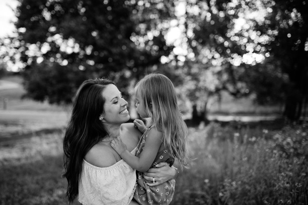 Candid black and white portrait of mother and daughter, mommy and me session at Shawnee Mission Park, Kansas City lifestyle photographer