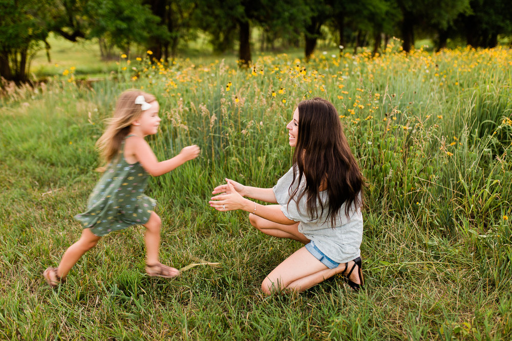 Daughter runs to her mother, mommy and me session at Shawnee Mission Park, Kansas City family photographer