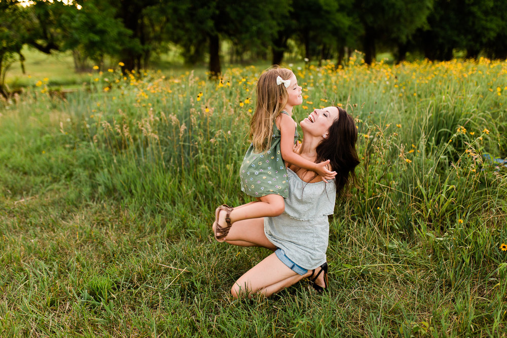 Mother catches her daughter, mommy and me session at Shawnee Mission Park, Kansas City family photographer