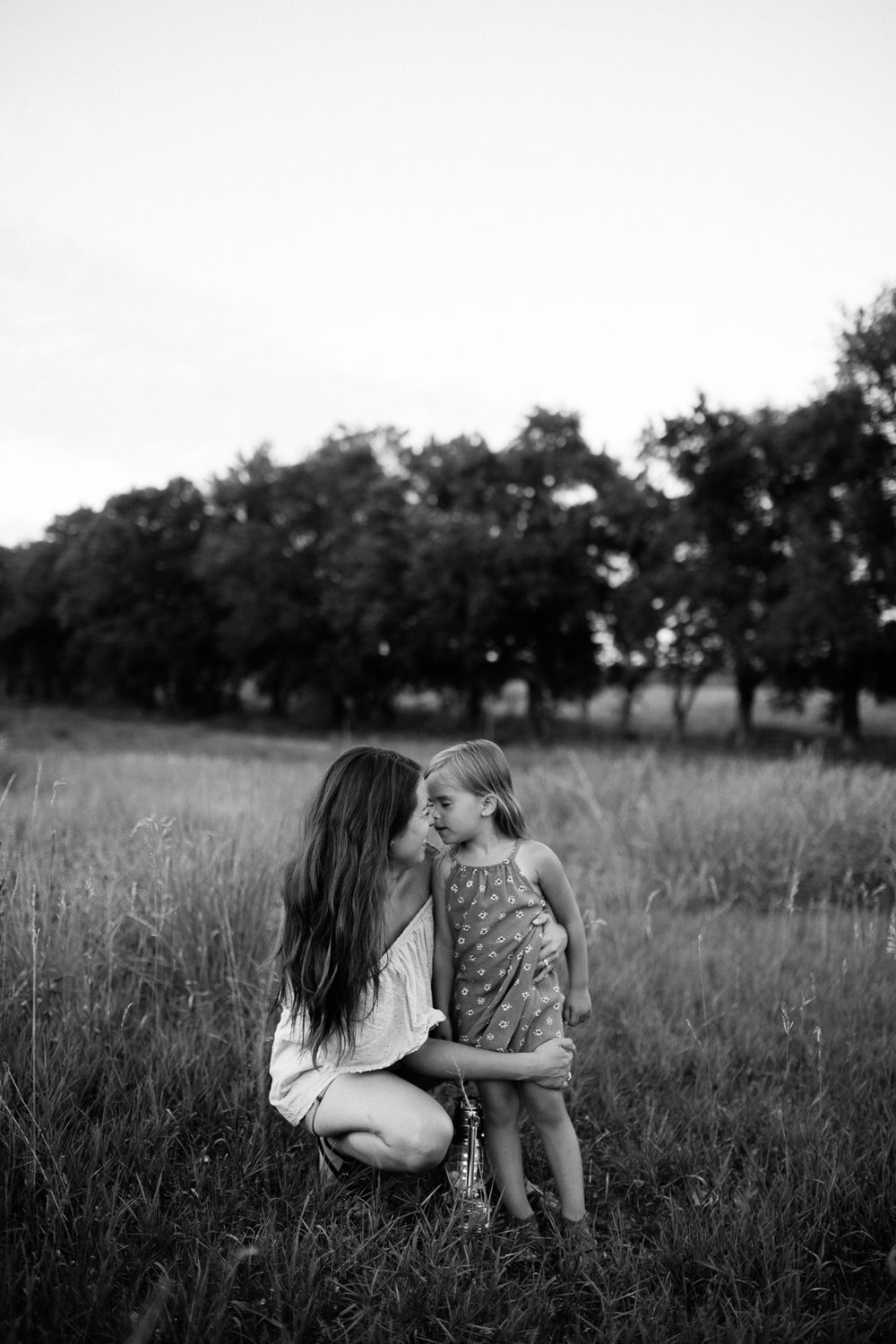 Black and white emotive portrait of mother and daughter, mommy and me session at Shawnee Mission Park, Kansas City lifestyle family photographer